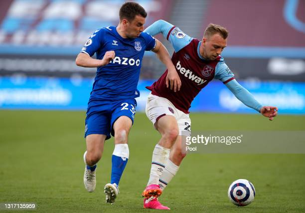 Jarrod Bowen of West Ham United battles for possession with Seamus Coleman of Everton during the Premier League match between West Ham United and...