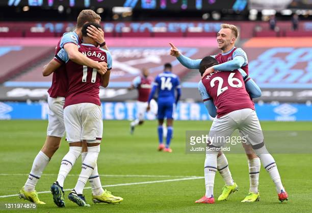 Jarrod Bowen of West Ham United celebrates with Arthur Masuaku after scoring their side's third goal during the Premier League match between West Ham...