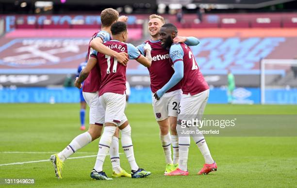 Jarrod Bowen of West Ham United celebrates with Jesse Lingard and Arthur Masuaku after scoring their side's third goal during the Premier League...