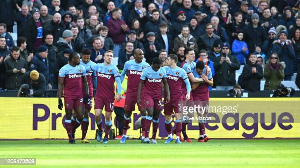 Jarrod Bowen of West Ham United celebrates with teammates after scoring his sides first goal during the Premier League match between West Ham United...