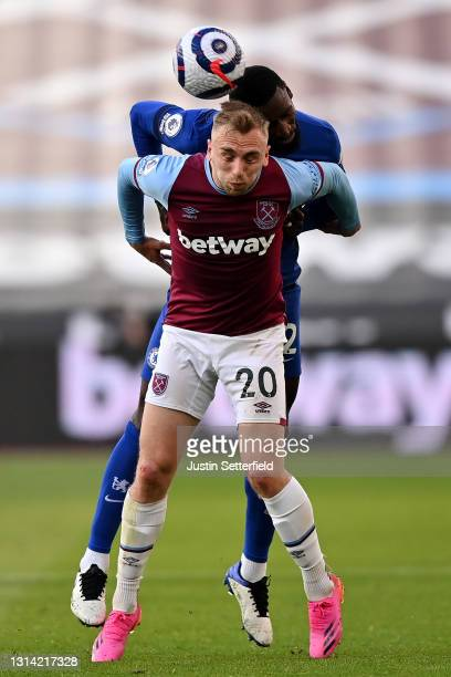 Jarrod Bowen of West Ham United challenges for the high ball with Antonio Ruediger of Chelsea during the Premier League match between West Ham United...