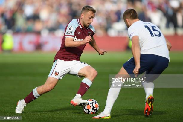 Jarrod Bowen of West Ham United is challenged by Eric Dier of Tottenham Hotspur during the Premier League match between West Ham United and Tottenham...
