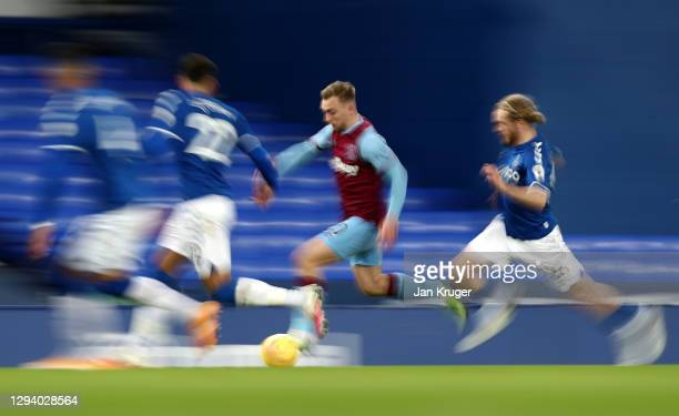 Jarrod Bowen of West Ham United is put under pressure by Tom Davies and Ben Godfrey of Everton during the Premier League match between Everton and...