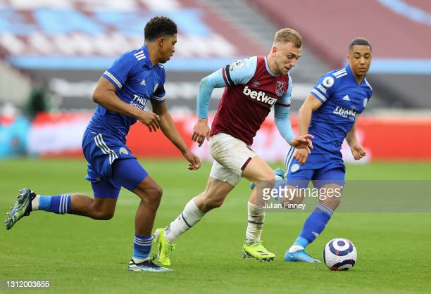 Jarrod Bowen of West Ham United is tackled by Wesley Fofana and Youri Tielemans of Leicester City during the Premier League match between West Ham...