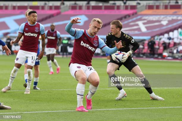 Jarrod Bowen of West Ham United looks dejected as he slows to a stop after missing a chance during the Premier League match between West Ham United...