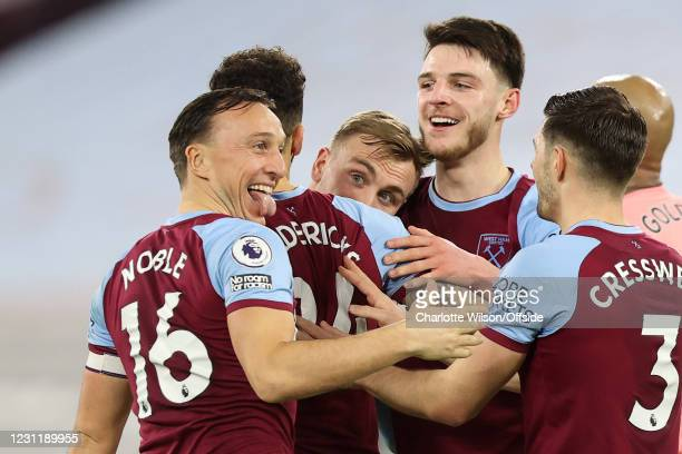 Jarrod Bowen of West Ham United looks over the shoulder of Ryan Fredericks as Mark Noble and Aaron Cresswell celebrate their 3rd goal scored by...