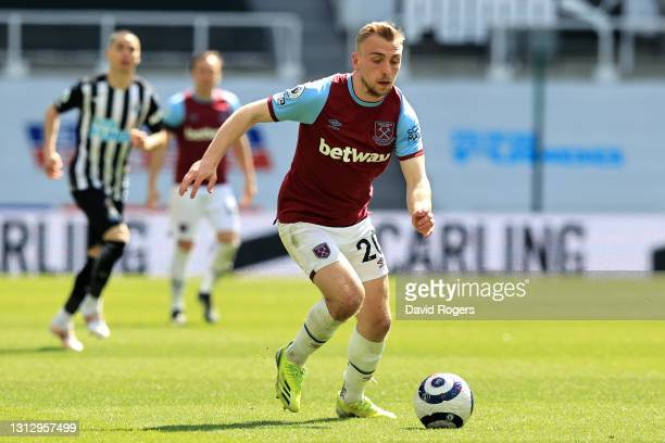Jarrod Bowen of West Ham United runs with the ball during the Premier League match between Newcastle United and West Ham United at St. James Park on...