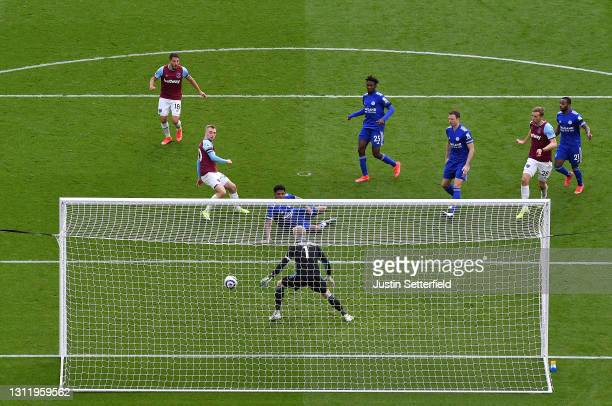 Jarrod Bowen of West Ham United scores their side's third goal past Kasper Schmeichel of Leicester City during the Premier League match between West...