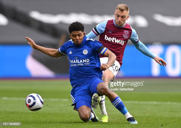 Jarrod Bowen of West Ham United scores their team's third goal past Wesley Fofana of Leicester City during the Premier League match between West Ham...