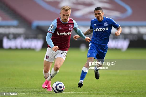 Jarrod Bowen of West Ham United takes on Allan of Everton during the Premier League match between West Ham United and Everton at London Stadium on...