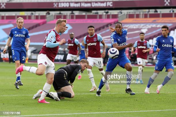 Jarrod Bowen of West Ham United tries to get past Everton goalkeeper Jordan Pickford to get to the ball for the rebound during the Premier League...