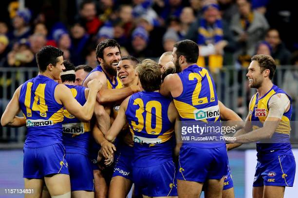 Jarrod Cameron of the Eagles is mobbed by team mates after scoring his first AFL goal during the round 14 AFL match between the West Coast Eagles and...