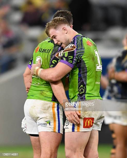 Jarrod Croker and Hudson Young of the Raiders celebrate after winning the round 12 NRL match between the North Queensland Cowboys and the Canberra...