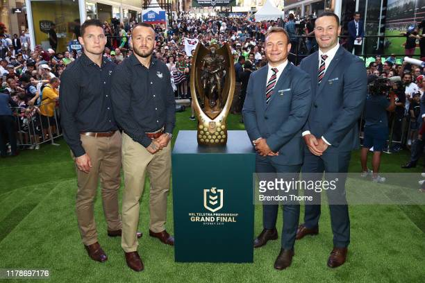 Jarrod Croker and Josh Hodgson of the Raiders & Jake Friend and Boyd Cordner of the Roosters pose with the Provan-Summons Trophy during the NRL Grand...