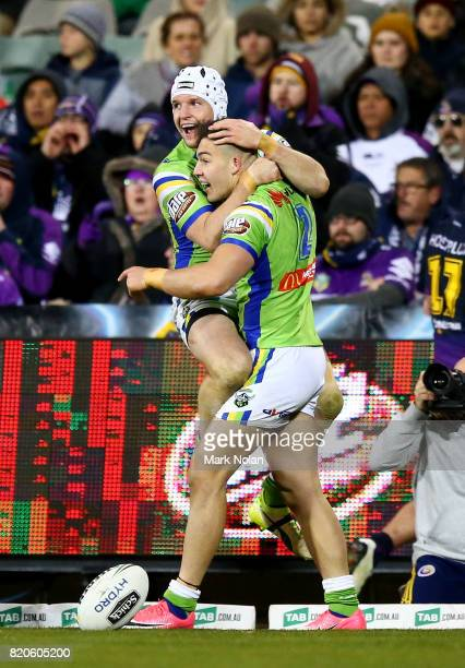 Jarrod Croker and Nikola Cotric of the Raiders celebrate a try by Cotric during the round 20 NRL match between the Canberra Raiders and the Melbourne...