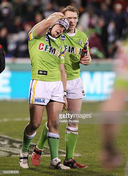 Jarrod Croker is consoled by Joel Monaghan of the Raiders after the first NRL semi final match between the Canberra Raiders and the Wests Tigers at...