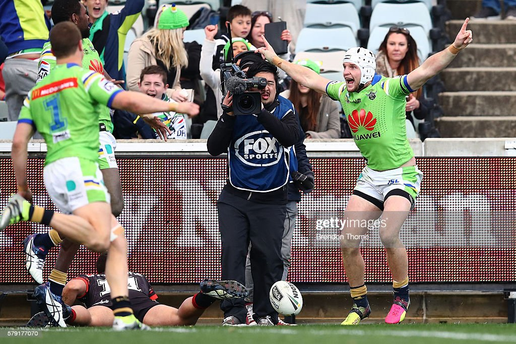 Jarrod Croker of the Raiders celebrates with team mates after scoring a try in golden point during the round 20 NRL match between the Canberra Raiders and the New Zealand Warriors at GIO Stadium on July 23, 2016 in Canberra, Australia.