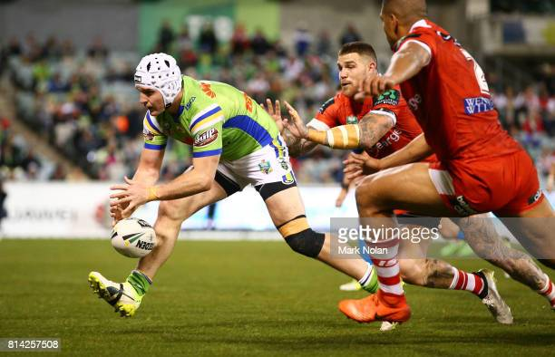 Jarrod Croker of the Raiders drops the ball while attempting to score during the round 19 NRL match between the Canberra Raiders and the St George...