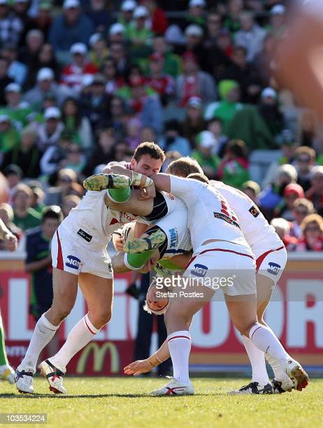 Jarrod Croker of the Raiders is tacked during the round 24 NRL match between the Canberra Raiders and the St George Illawarra Dragons at Canberra...