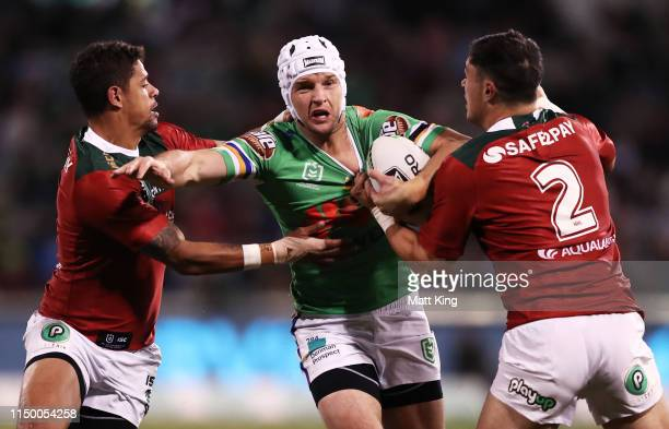 Jarrod Croker of the Raiders is tackled during the round 10 NRL match between the Canberra Raiders and the South Sydney Rabbitohs at GIO Stadium on...