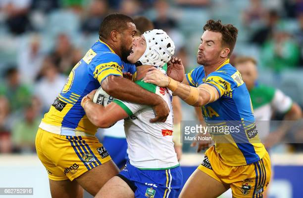 Jarrod Croker of the Raiders is tackled during the round five NRL match between the Canberra Raiders and the Parramatta Eels at GIO Stadium on April...