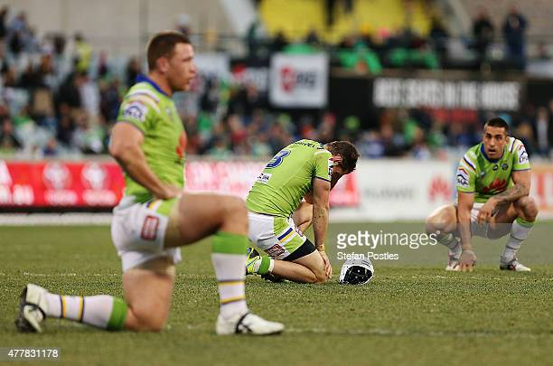 Jarrod Croker of the Raiders reacts after Johnathan Thurston of the Cowboys kicks a field goal to win the round 15 NRL match between the Canberra...