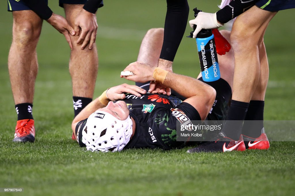 Jarrod Croker of the Raiders receives attention from the trainer during the round 10 NRL match between the Canberra Raiders and the Cronulla Sharks at GIO Stadium on May 13, 2018 in Canberra, Australia.