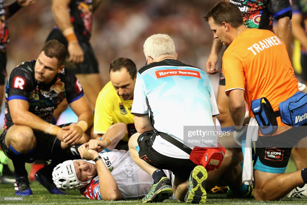 Jarrod Croker of the World All Stars lays on the ground injured attended to by a trainer during the NRL All Stars match between the 2017 Harvey Norman All Stars and the NRL World All Stars at McDonald Jones Stadium on February 10, 2017 in Newcastle, Australia.