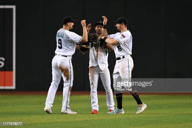 Jarrod Dyson Josh Rojas and Tim Locastro of the Arizona Diamondbacks celebrate a 63 win against the San Diego Padres at Chase Field on September 27...