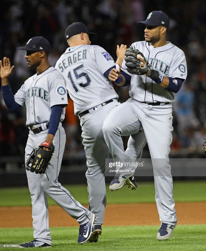 Jarrod Dyson #1, Kyle Seager #15 and Robinson Cano #22 of the Seattle Mariners celebrate a win over the Chicago White Sox at Guaranteed Rate Field on July 15, 2017 in Chicago, Illinois. The Mariners defeated the White Sox 4-3.