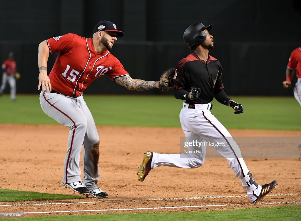 Jarrod Dyson #1 of the Arizona Diamondbacks is tagged out by Matt Adams #15 of the Washington Nationals while running up the first base line during the ninth inning at Chase Field on May 12, 2018 in Phoenix, Arizona. Nationals won 2-1.