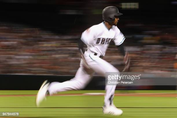 Jarrod Dyson of the Arizona Diamondbacks runs to first base on a ground ball out against the San Francisco Giants during the third inning of the MLB...