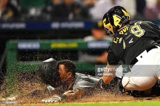 Jarrod Dyson of the Arizona Diamondbacks scores in front of Francisco Cervelli of the Pittsburgh Pirates during the sixth inning at PNC Park on April...