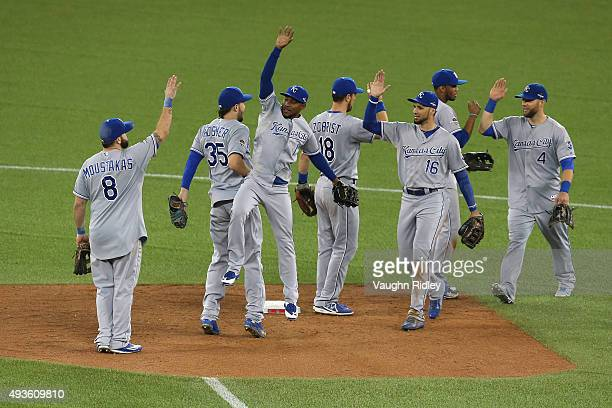 Jarrod Dyson of the Kansas City Royals celebrates with teammates after defeating the Toronto Blue Jays 142 in game four of the American League...