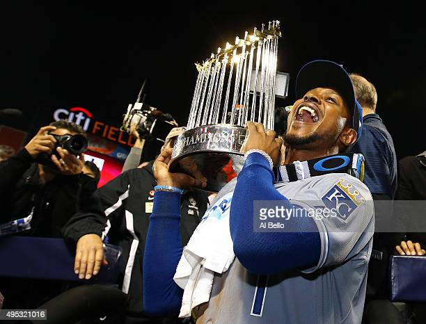 Jarrod Dyson of the Kansas City Royals celebrates with the Commissioner's Trophy after defeating the New York Mets to win Game Five of the 2015 World...
