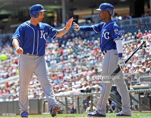 Jarrod Dyson of the Kansas City Royals congratulates teammate Raul Ibanez on scoring a run against the Minnesota Twins during the second inning of...