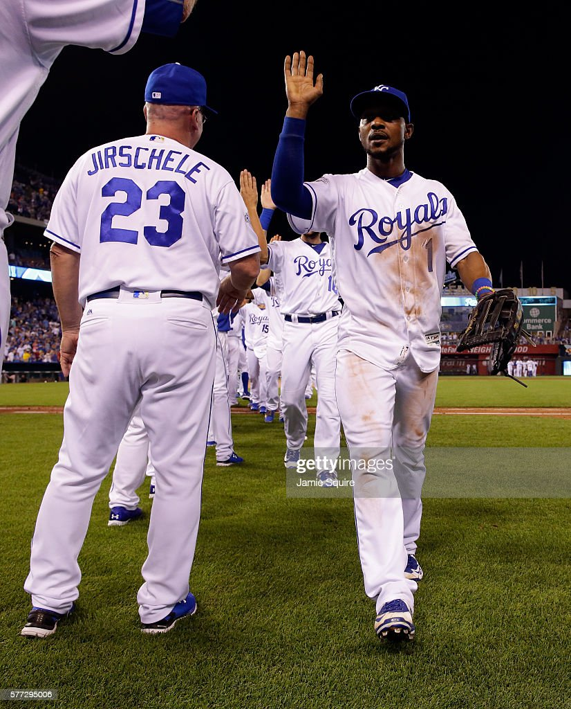 Jarrod Dyson #1 of the Kansas City Royals is congratulated by third base coach Mike Jirschele #23 after the Royals defeated the Cleveland Indians 7-3-to win the game at Kauffman Stadium on July 18, 2016 in Kansas City, Missouri.