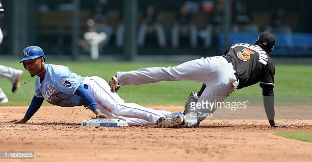 Jarrod Dyson of the Kansas City Royals slides into second for a steal past Adeiny Hechavarria of the Miami Marlins in the third inning at Kauffman...