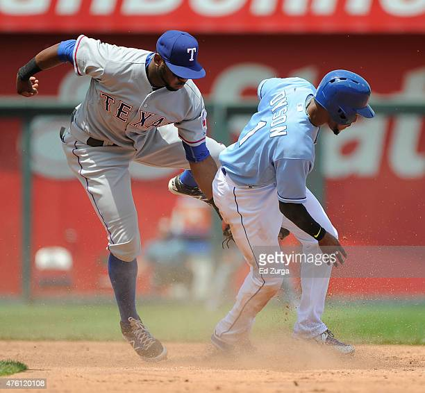Jarrod Dyson of the Kansas City Royals slides into second for a steal past Hanser Alberto of the Texas Rangers in the third inning at Kauffman...