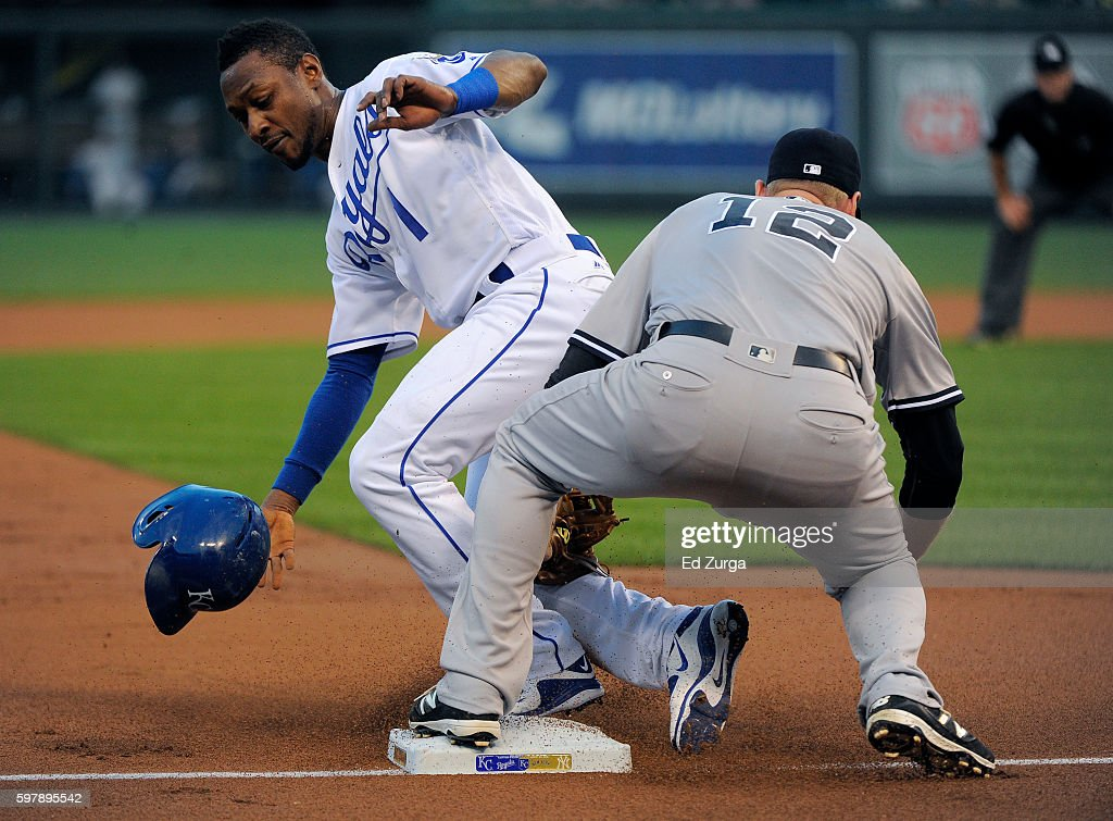 Jarrod Dyson #1 of the Kansas City Royals slides into third for a steal past the tag of Chase Headley #12 of the New York Yankees in the first inning at Kauffman Stadium on August 29, 2016 in Kansas City, Missouri.