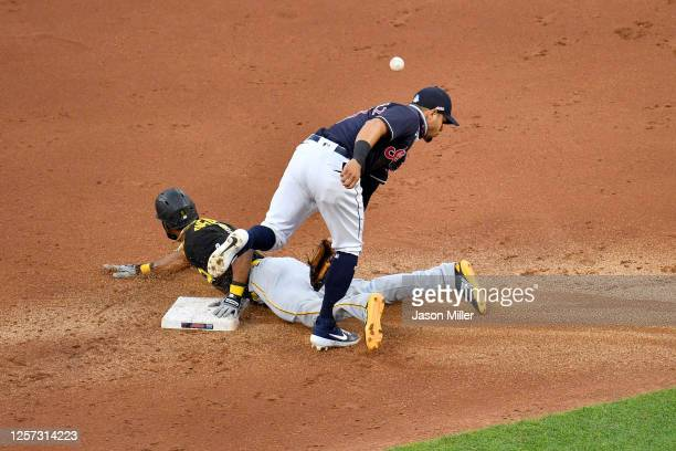Jarrod Dyson of the Pittsburgh Pirates steals second base as second baseman Cesar Hernandez of the Cleveland Indians misses the catch during the...