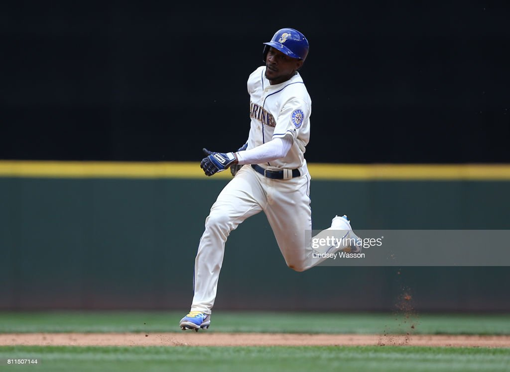 Jarrod Dyson #1 of the Seattle Mariners makes the run to third base on a single by Carlos Ruiz of the Seattle Mariners in the third inning at Safeco Field on July 9, 2017 in Seattle, Washington.