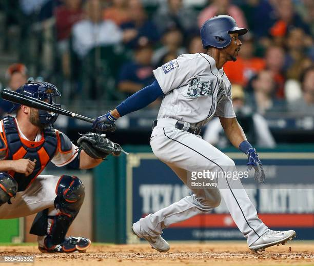 Jarrod Dyson of the Seattle Mariners singles a run in the ninth inning against the Houston Astros at Minute Maid Park on April 6 2017 in Houston Texas