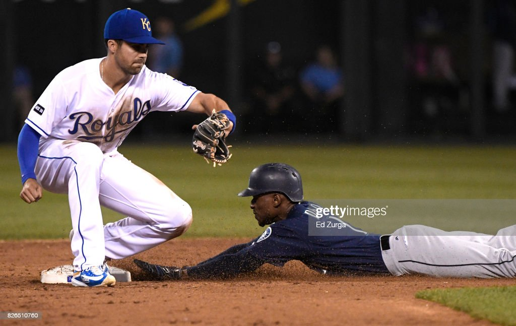 Jarrod Dyson #1 of the Seattle Mariners slides into second for a steal past Whit Merrifield #15 of the Kansas City Royals in the seventh inning at Kauffman Stadium on August 4, 2017 in Kansas City, Missouri.
