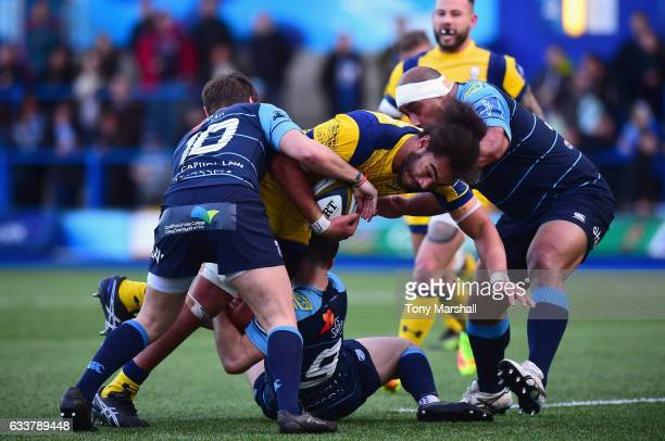 Jarrod Evans and Tomos Williams of Cardiff Blues tackle Chris Vui of Worcester Warriors during the AngloWelsh Cup match between Cardiff Blues and...
