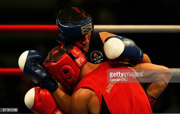 Jarrod Fletcher of Australia exchanges punches with James Degale of England in the Men's Middleweight 75 kg Semifinal bout during the boxing at the...
