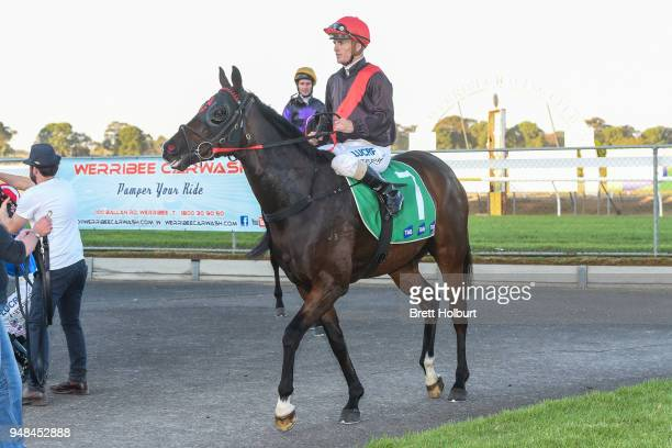 Jarrod Fry returns to the mounting yard on Crisis Point after winning the Werribee Open Range Zoo BM58 Handicap at Werribee Racecourse on April 19...