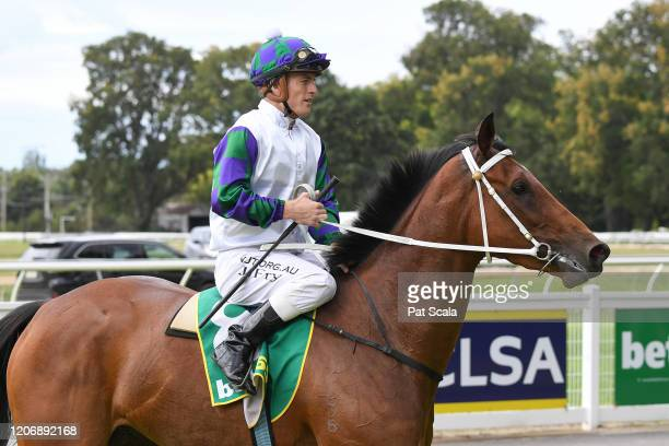Jarrod Fry returns to the mounting yard on Mamelon after winning the bet365 Maiden Plate at Kyneton Racecourse on March 13 2020 in Kyneton Australia