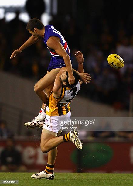 Jarrod Harbrow of the Bulldogs clashes with Jordan Lewis of the Hawks during the round three AFL match between the Western Bulldogs and the Hawthorn...