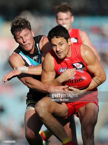 Jarrod Harbrow of the Suns competes for the ball with Brad Ebert of the Power during the round 21 AFL match between Port Adelaide Power and the Gold...